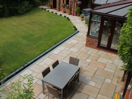 Patios - Great looking patios can come in all different shapes and sizes. We have a range of natural stone, circle sets and imprinted concrete designs to choose from.