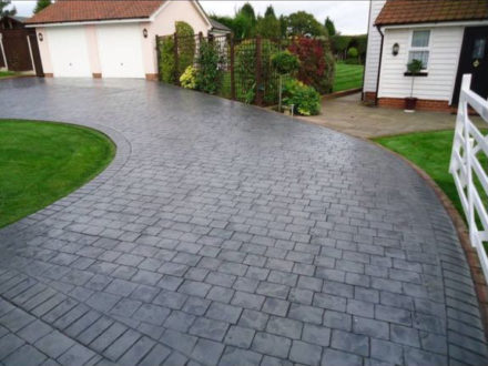 Imprinted concrete - Perfect for driveways, forecourts and patios because it offers sheer versatility in shape, texture, colour and design options. It's resistant to stains and is weed free — low maintenance.